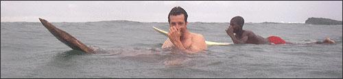 Michael Scott Moore on a hand-carved African board in the water off Sao Tome.