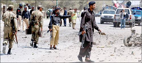 Pakistan police and soldiers at the site of a bomb blast in Quetta, Pakistan, June 20, 2010. (AP)
