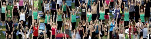 People take a yoga class from acclaimed yogi, Elena Brower on the great lawn of Central Park, June 22, 2010 in New York. (AP)