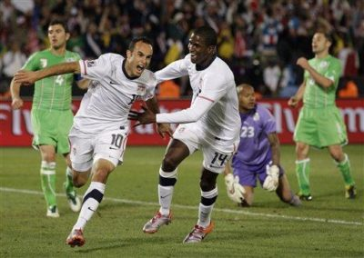 Landon Donovan (left) and Edson Buddle (right) of the USA national soccer team celebrate after Donovan's game-winning goal against Algeria in Pretoria, South Africa, Wednesday June 23, 2010 (AP Photo/Elise Amendola)