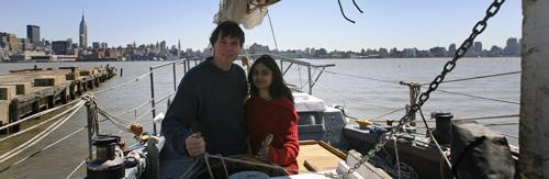 Reid Stowe and Soanya Ahmad stand aboard their 70 foot gaff-rigged Schooner Anne, Friday, April 20, 2007(AP)