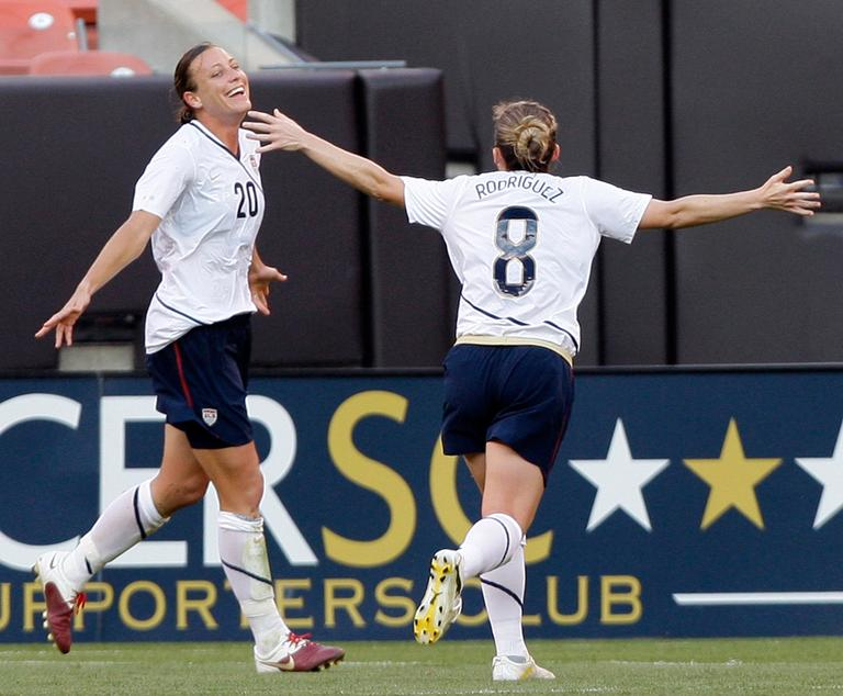 "Abby Wambach (20) celebrates a U.S. Soccer goal with teammate Amy Rodriguez in a match in May. Wambach chose her ""side"" in the WPS All-Star Game. (AP)"