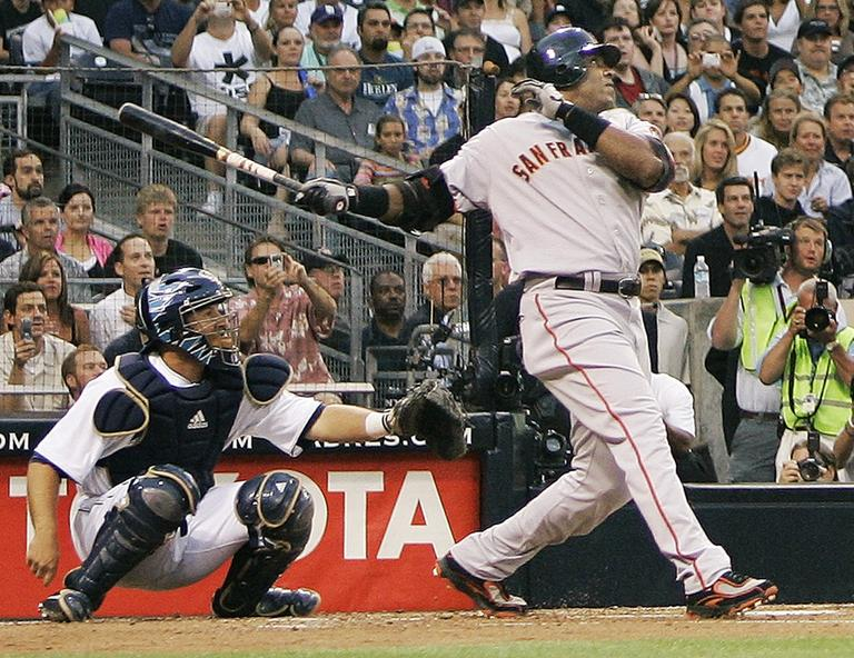 San Francisco Giants' Barry Bonds watches a home run, his 755th, in August of 2007. With the hit, Bonds tied Hank Aaron's career home run record. (AP)