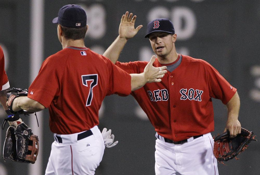 Daniel Nava, right, and  J.D. Drew celebrate a 3-2 win over the Orioles, Friday.  Drew had two solo home runs and Nava had an RBI single, which broke a 2-2 tie, in the Red Sox win.(AP Photo/Charles Krupa)