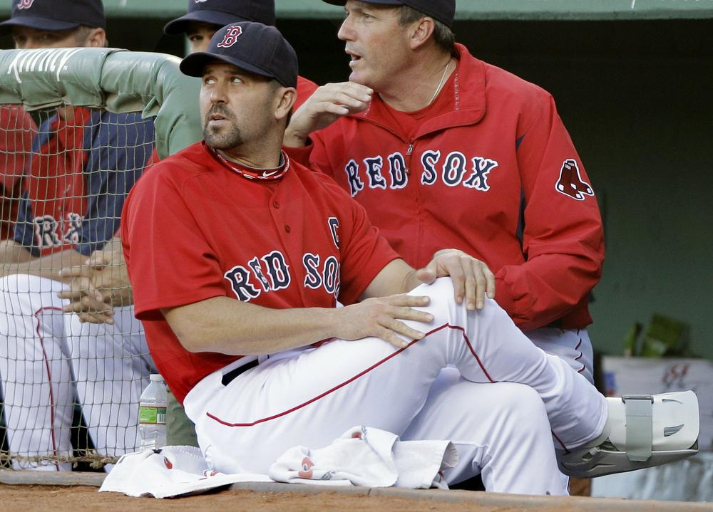 With his right foot in a cast,  Red Sox catcher Jason Varitek watches the first inning against the Orioles at Fenway Park , Friday.(AP Photo/Charles Krupa)