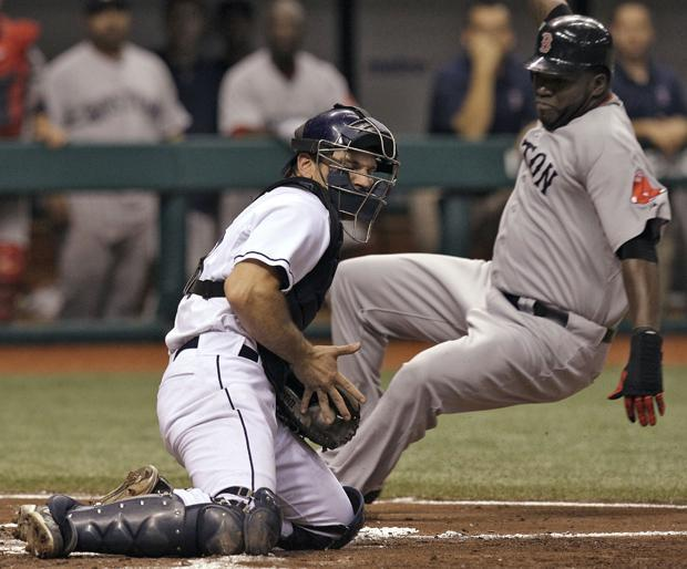 Boston's David Ortiz slides in ahead of the tag by Tampa Bay catcher John Jaso during the third inning of the game on Monday in St. Petersburg, Fla. Ortiz scored on a triple by teammate Kevin Youkilis. (AP)