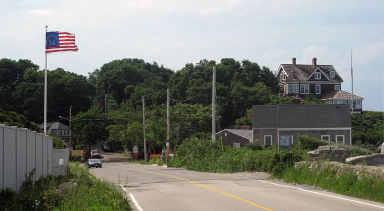 This flagpole marks the town line between Cohasset, foreground, and Hull, rear. (Fred Thys/WBUR)