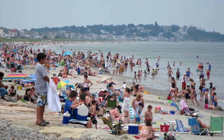 A busy summer day on a beach in Hull. (Fred Thys/WBUR)