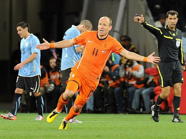 The Netherlands' Arjen Robben celebrates after his second-half goal gave the Dutch a 3-1 lead over Uruguay. (AP)