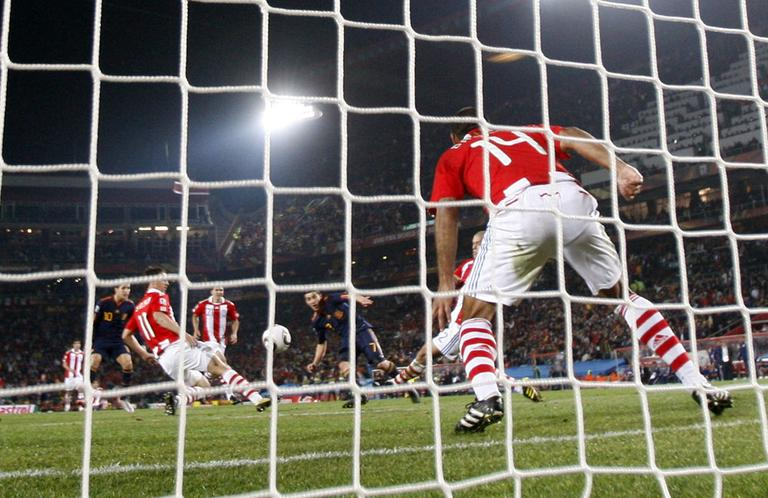 David Villa, center, scores the winning goal that beat Paraguay and sent Spain into the World Cup semifinals. (AP)
