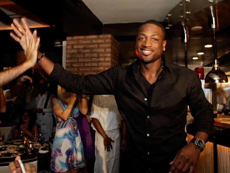 "Dwyane Wade is all smiles now that ""The King"" is heading to South Beach. (AP)"