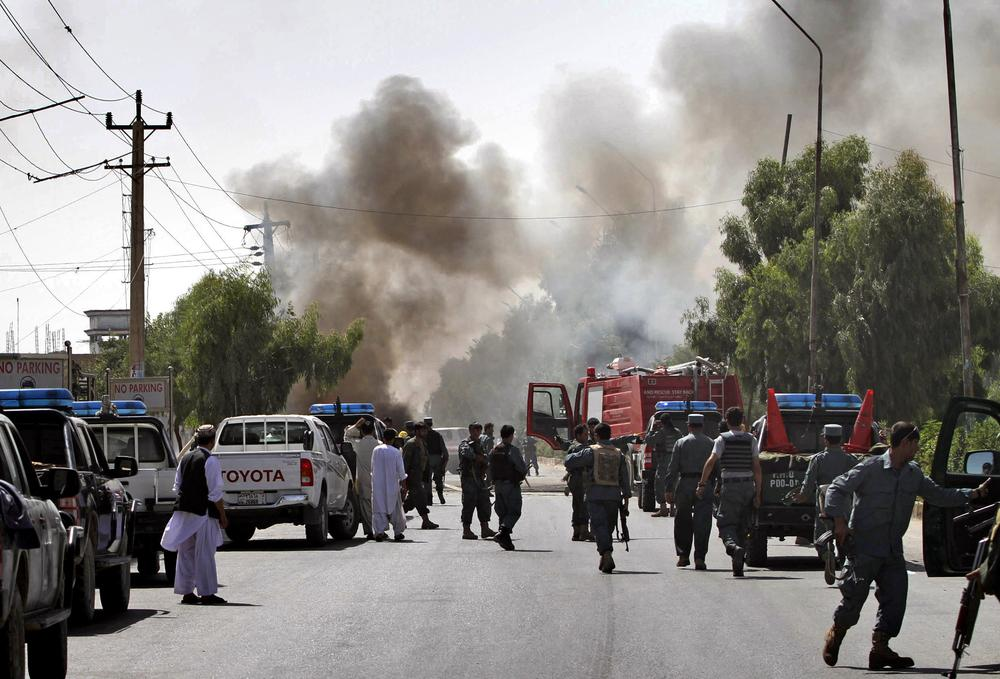 Smoke comes out from the scene of an explosion in Kandahar south of Kabul, Afghanistan on Saturday. One bystander was killed when the bomb, concealed in a parked motorcycle, exploded in the middle of the afternoon, said  the city's security chief. (AP Photo/Allauddin Khan)