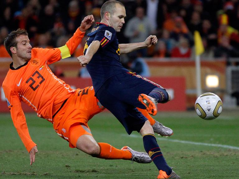 Spain's Andres Iniesta (right) scores a goal past Rafael van der Vaart of the Netherlands on Sunday during the World Cup final soccer match. Spain won 1-0. (AP)