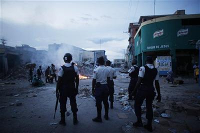 Police patrol in downtown Port-au-Prince, Haiti in July.  (AP)