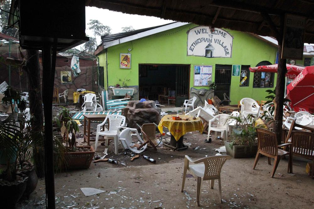 Damaged chairs and tables amongst the debris strewn outside the Ethiopian Village restaurant in Kampala, Uganda, on Monday after an explosion at the restaurant late Sunday. (AP)