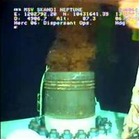 In a photo made from video released by BP PLC, oil emerges from a cap placed on the broken wellhead at the former site of the Deepwater Horizon oil rig Tuesday morning July13, 2010 at 8:00 a.m. EDT in the Gulf of Mexico.  After securing a new, tight-fitting cap on top of the leaking well, BP prepared Tuesday to begin tests to see if it will hold and stop fresh oil from polluting the waters for the first time in nearly three months.  (AP Photo/BP PLC)  NO SALES