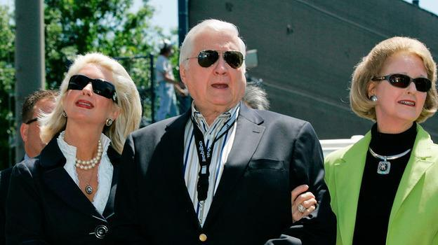 In this March 27, 2008 file photo, New York Yankees senior vice president for new stadium public affairs Jennifer Steinbrenner Swindal, left, holds onto her father and Yankees principal owner George Steinbrenner, center, along with his wife, Joan, during a pregame ceremony renaming Legends Field to George M. Steinbrenner Field at spring training baseball, in Tampa, Fla. (AP)