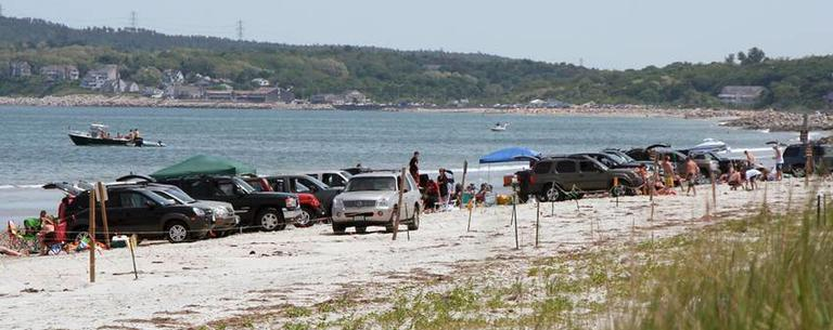 Vehicles are parked near the water at Plymouth Beach. (Courtesy Goldenrod Foundation)