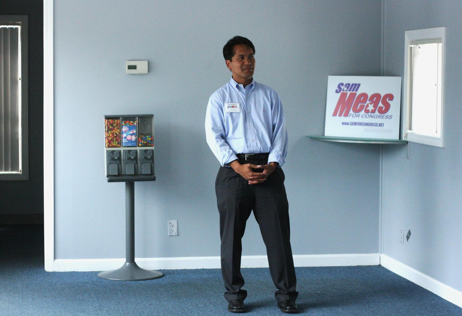 Sam Meas stands in a brand-new, empty campaign office in Lowell. (Jess Bidgood for WBUR)