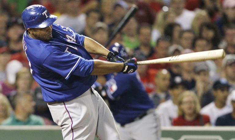 Texas Rangers' Nelson Cruz follows through on a single against the Boston Red Sox during the fifth inning of their baseball game in Boston, Thursday, July 15, 2010. (AP)