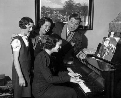 Babe Ruth and his family celebrate his 40th birthday in New York in 1934. The family is shown around a piano, though not the piano Sudbury, Ma. resident Kevin Kenney has searched for. (AP)