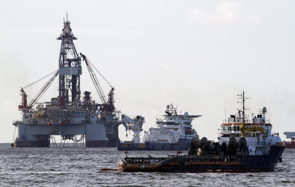 Vessels assisting in the capping of the Deepwater Horizon oil wellhead are seen on the Gulf of Mexico near the coast of Louisiana Friday. (AP)