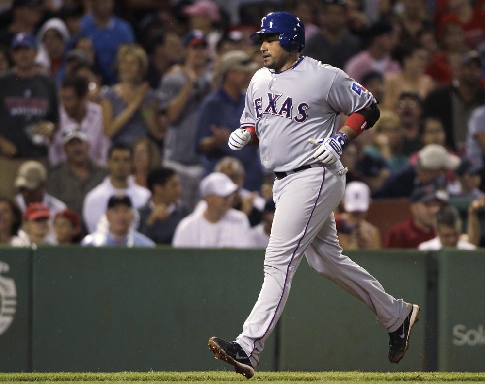 Rangers' Bengie Molina heads home on his grand slam against the Red Sox during the fifth inning in Boston, Friday.(AP Photo/Charles Krupa)