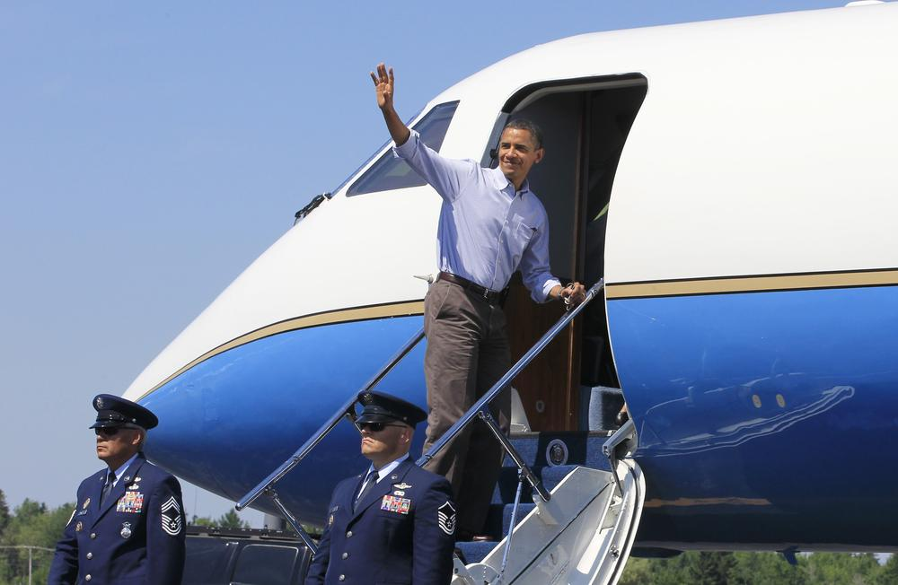President Obama boards Air Force One at Hancock County Bar Harbor Airport in Trenton, Maine, on Sunday. (AP)