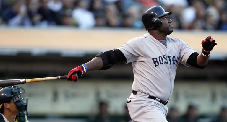Boston Red Sox's David Ortiz follows through on an RBI sacrifice fly off Oakland Athletics' Ben Sheets. (AP)