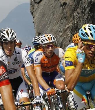 From left to right- Andy Schleck of Luxembourg, Denis Menchov of Russia, and Alberto Contador of Spain climb the Aubisque pass during the 16th stage of the Tour de France. (AP)