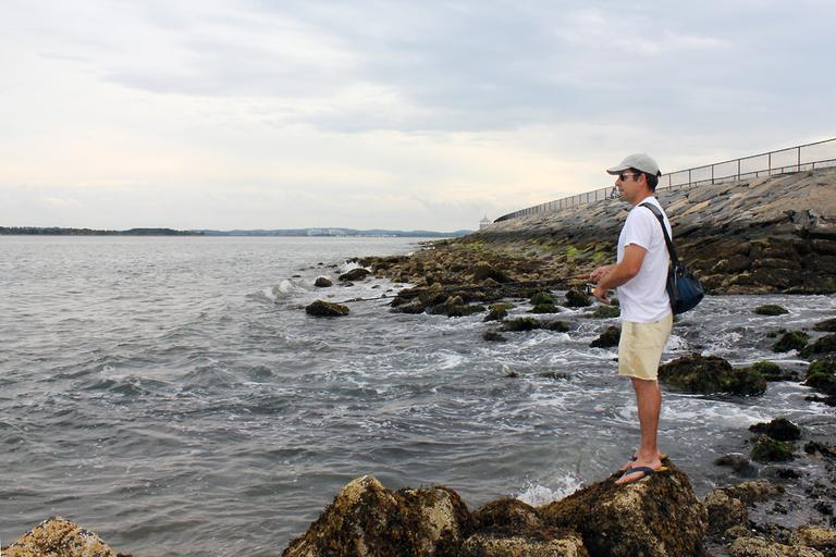 Andrew Mowbray, an artist in Dorchester, fishes on Castle Island three to four times a week. (Lisa Tobin/WBUR)