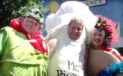 "The ring leaders of the Pierogi Festival in Whiting, Indiana: from left to right-""Halupki Guy,"" ""Mr. Pierogi"" and ""Ms. Paczki."" (Pierogifest.net)"