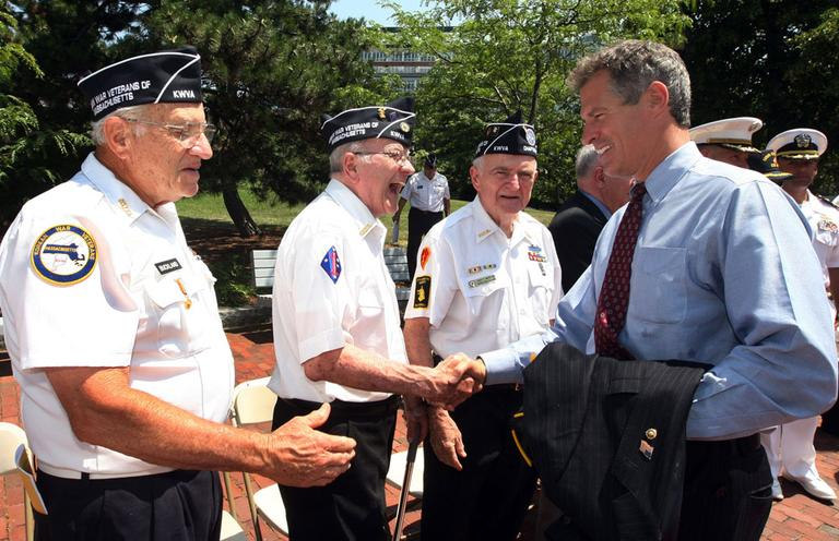 Sen. Scott  Brown, right, shakes hands with Korean War veterans Wallace Decourcey, of Newton, left, Jack Dowd, of Somerville, center, and Joe McCallion, of Wakefield, on June 25, after a Korean War ceremony in Charlestown. (AP)