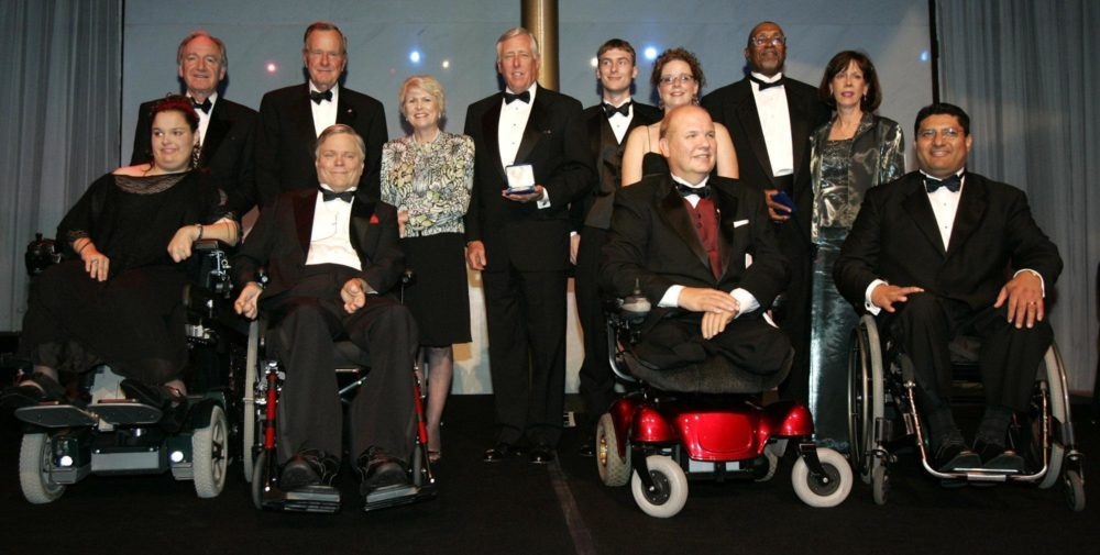 Former President George H.W. Bush with recipients of the George Bush Medal for the Empowerment of People with Disabilities in 2005. (Haraz N. Ghanbari/AP)