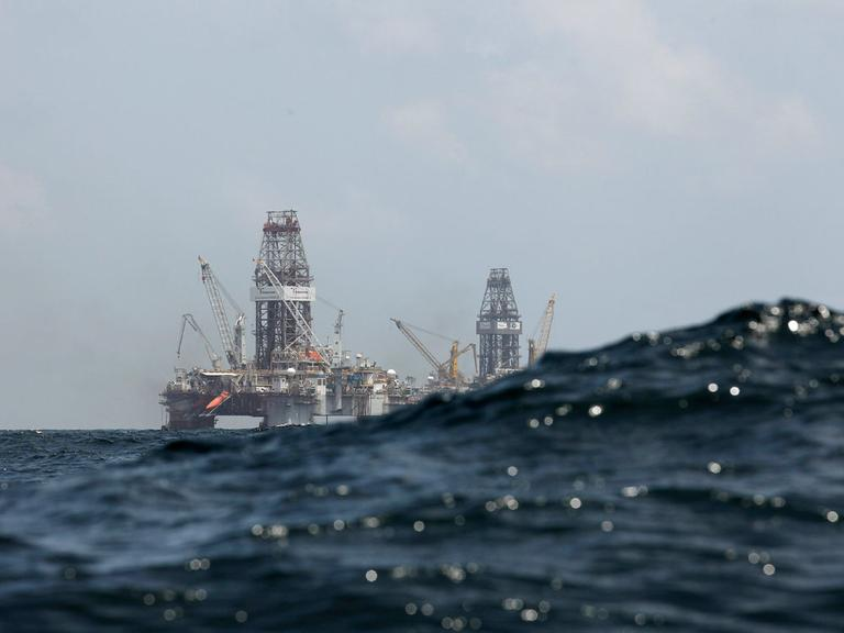Waves partially obscure the Development Driller II (left) and Development Driller III, which are drilling the relief wells at the Deepwater Horizon oil spill site in the Gulf of Mexico. (AP)