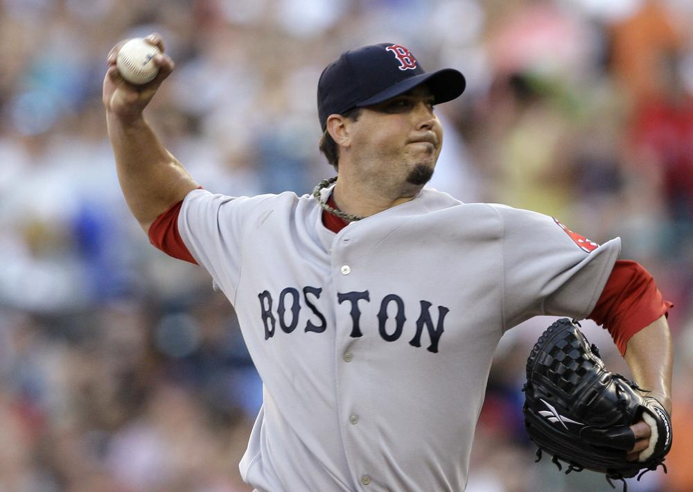 Josh Beckett throws against the Mariners in the first inning  Friday in Seattle. (AP Photo/Elaine Thompson)