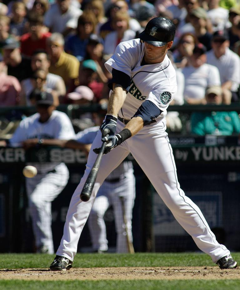 Seattle Mariners' Michael Saunders lines a two-run single against the Boston Red Sox in the eighth inning on Sunday in Seattle. (AP)