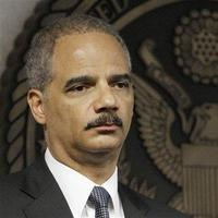 Attorney General Eric Holder looks on during a news conference in Miami, Friday, July 16, 2010. Federal authorities said they are conducting the largest Medicare fraud bust ever in five different states and arrested dozens of suspects accused in scams totaling $251 million. (AP Photo/Alan Diaz)
