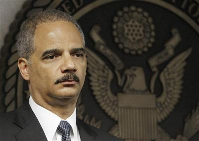 Attorney General Eric Holder looks on during a news conference in Miami in July.  (AP )