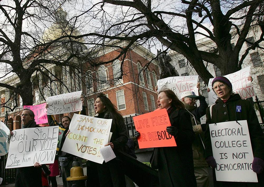 In December 2004, as the state's Electoral College members were sworn in at the State House, protesters outside demonstrated their opposition to the system. (Michael Dwyer/AP)