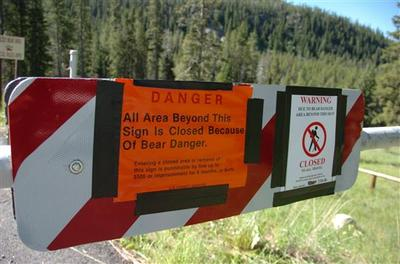 A sign at the entrance of the Soda Butte Campground outside Cooke City, Mont. warns would-be visitors to stay out after a man was killed and two people injured when a bear rampaged through the campground. (AP)