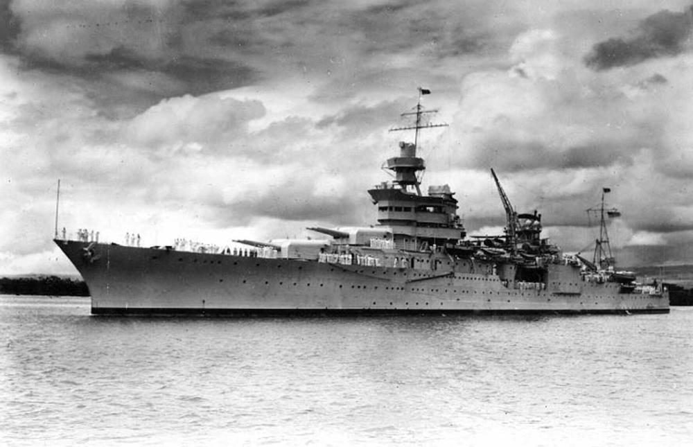 The USS Indianapolis at Pearl Harbor, Hawaii, circa 1937.  On July 30, 1945, a Japanese submarine torpedoed the Indianapolis, tearing the ship nearly in two, destroying much of the bow and igniting a firestorm below decks. Within 12 minutes, the vessel was gone and 300 crewmen were dead.  (Naval Historical Center via AP)