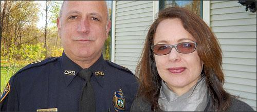 "Jessica with Lt. Paul Macone, the detective who solved a cold, hard case in ""Denial""."