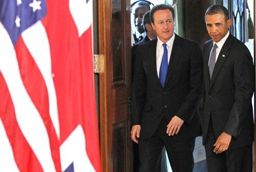 Pres. Barack Obama and British Prime Minister David Cameron arrive for a joint news conference at the White House, July 20, 2010. (AP)