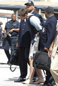Colton Harris-Moore arrives barefoot, handcuffed and shackled as he is escorted by police to Nassau, Bahamas, July 11, 2010. (Credit: flickr/underthelaw)