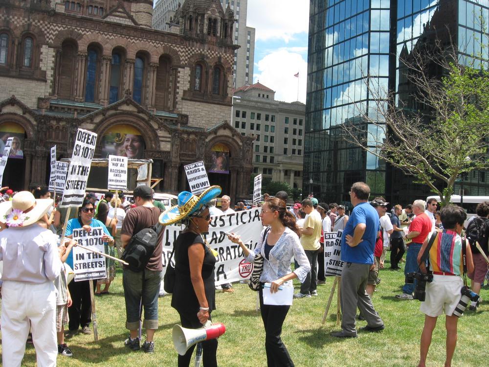 Immigration advocates protest in Copley Square. (Sacha Pfeiffer/WBUR)