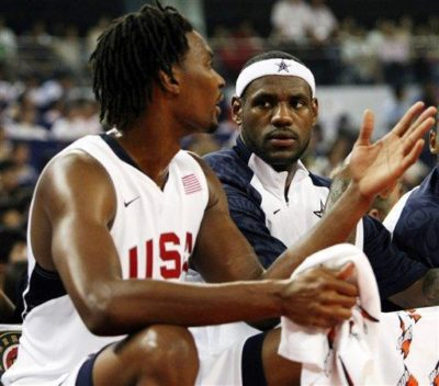 LeBron James and Chris Bosh chat on the bench during a USA men's basketball game during the 2008 Summer Olympics. LeBron will join Bosh and Dwyane Wade with the Miami Heat next season. (AP Photo/Eugene Hoshiko, File)