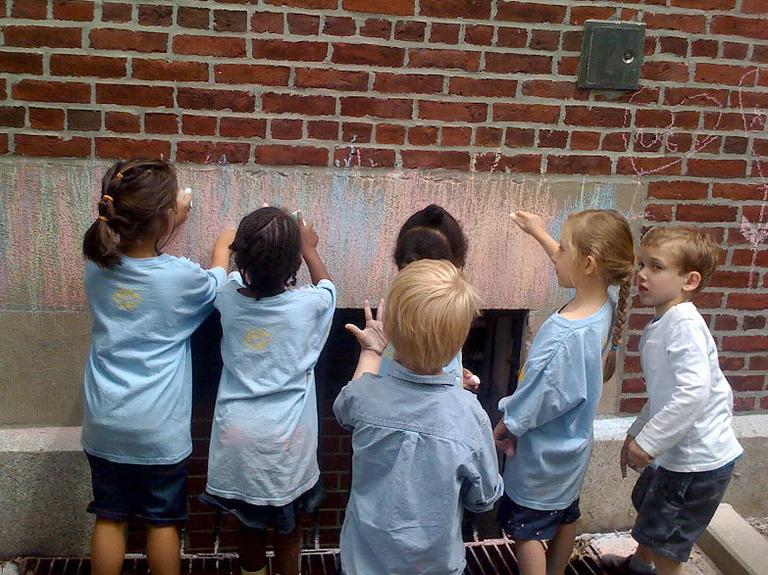 Kindergarten students draw with chalk at Ellis Mendell Elementary School. (Courtesy of Kristin Barrali)