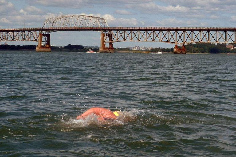 Elaine Howley swims near Boston Harbor's Long Island Bridge in 2006. (Courtesy of Elaine Howley)