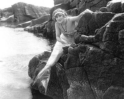 """Annette Kellerman, in mermaid costume for the role of """"Merrilla, the Queen of the Sea,"""" nearly swam from Revere Beach to Boston Light in 1908. (Courtesy)"""